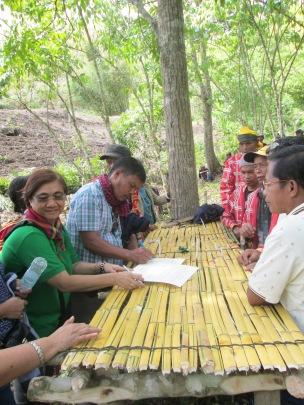 The signing of Statement of Management and Responsibilty -- Datu Amado Mansabid